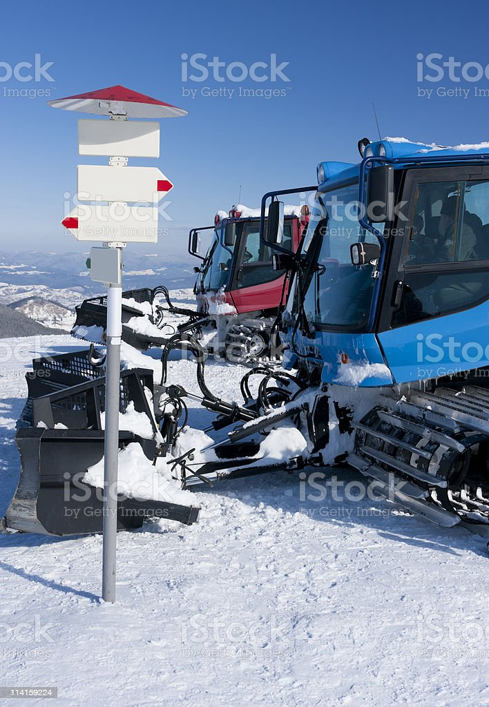 Two snowcats and the signboard. royalty-free stock photo