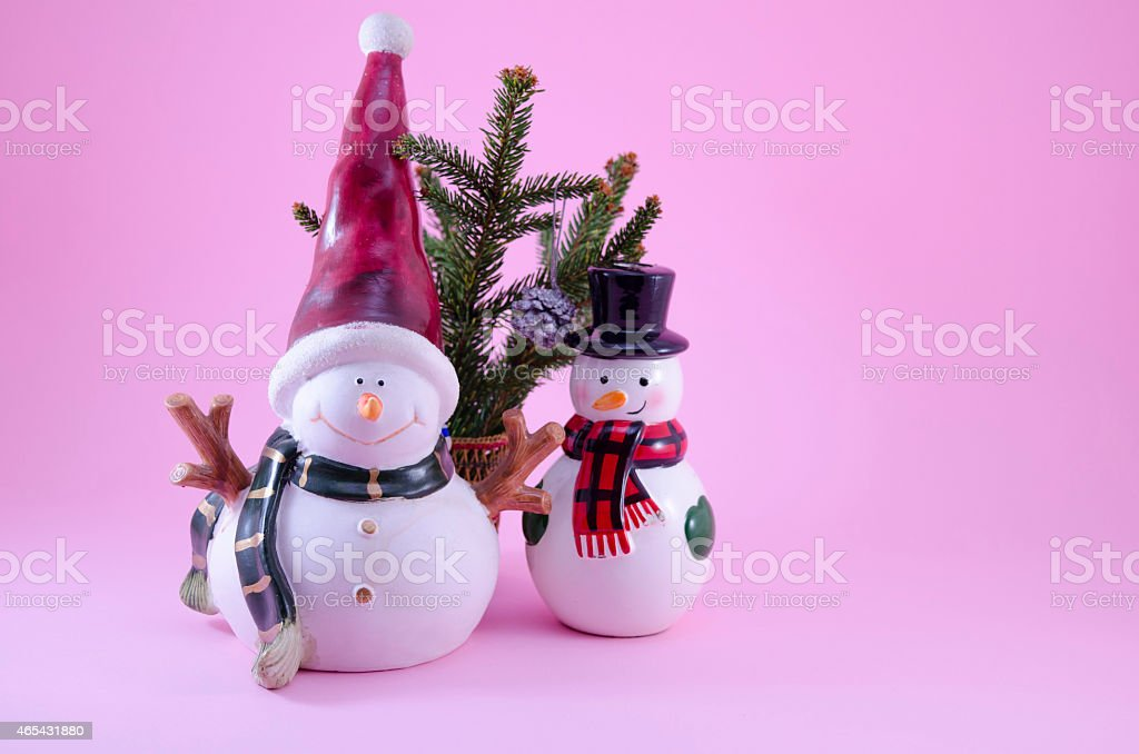 Two snowmen and a fir tree royalty-free stock photo