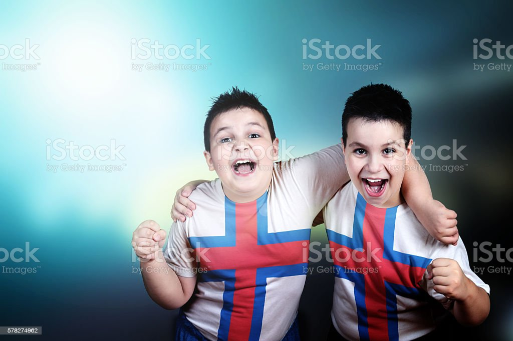 Two soccer fans with flag of Faroe Islands on t-shirt stock photo