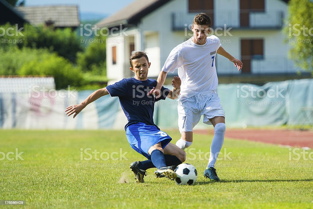 Two soccer players duelling stock photo