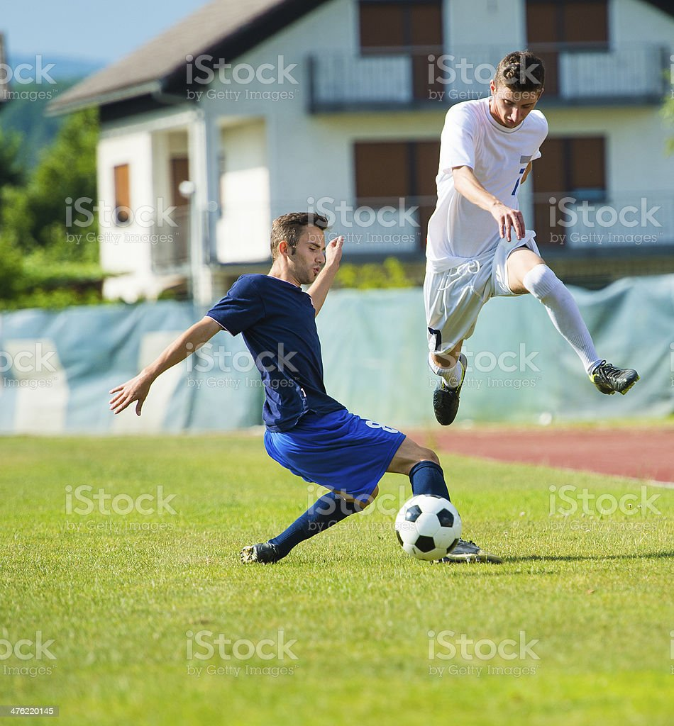 Two soccer players duelling royalty-free stock photo