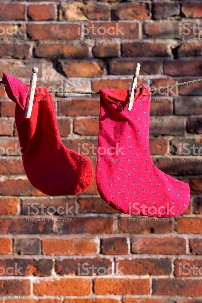 Two socks drying on a washing line royalty-free stock photo