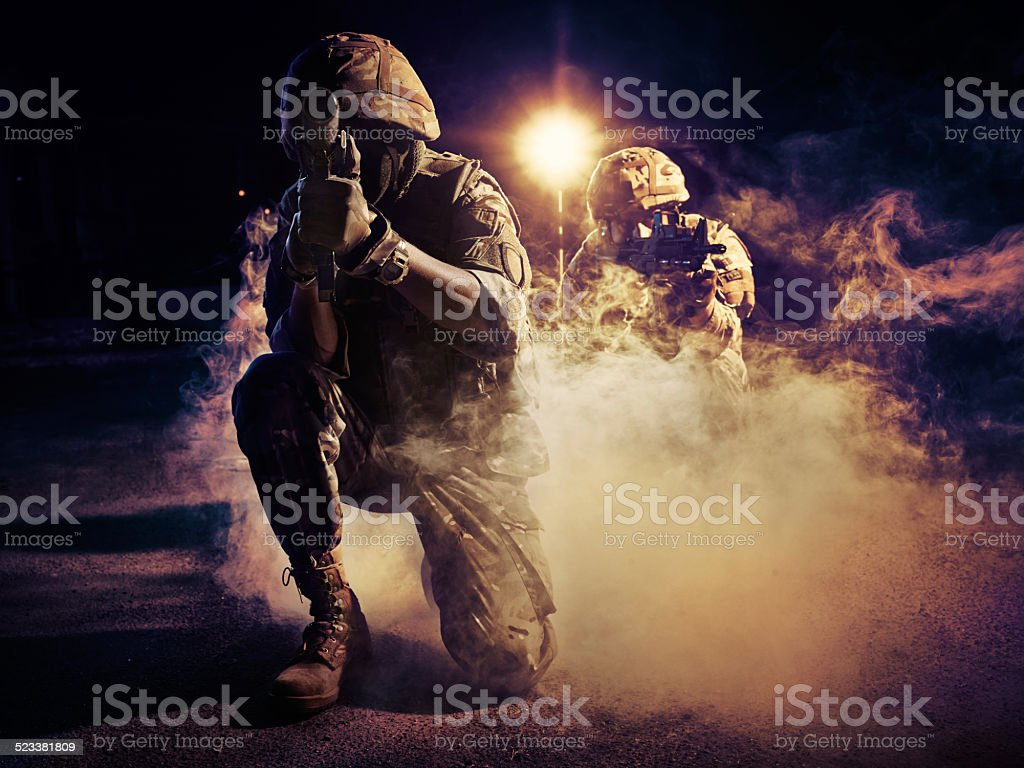 two soldiers in action stock photo