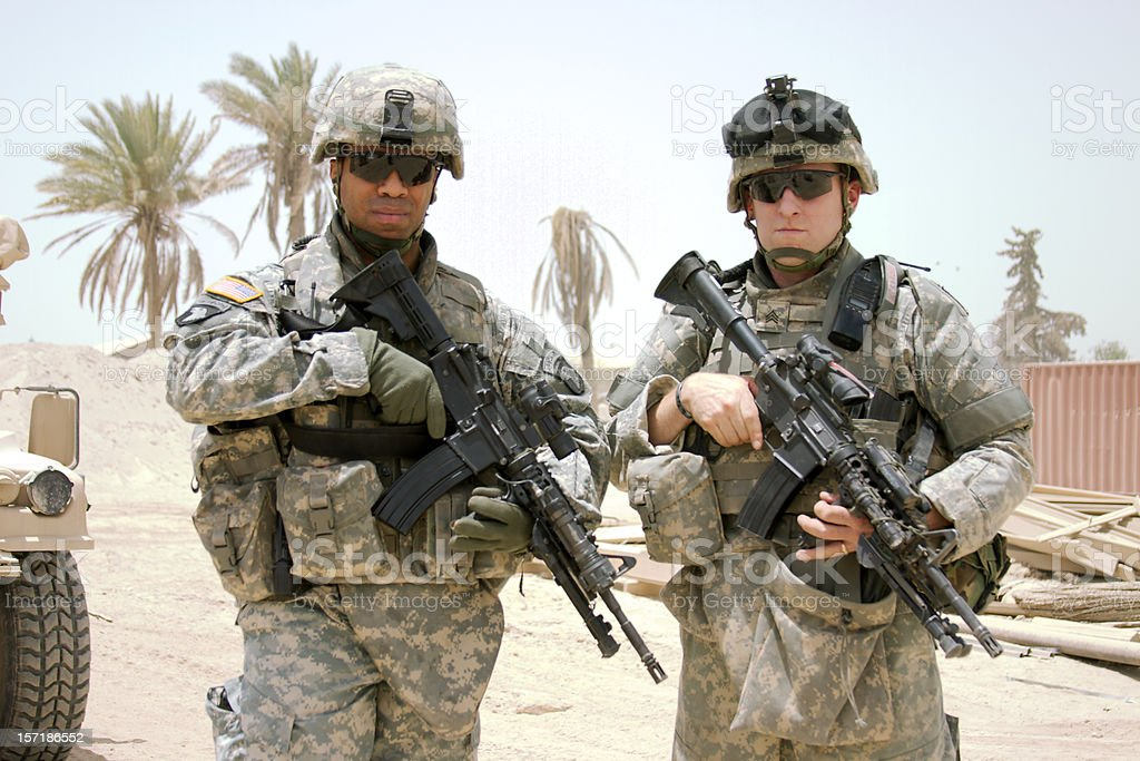 Two soldiers posing on camera in the middle east stock photo