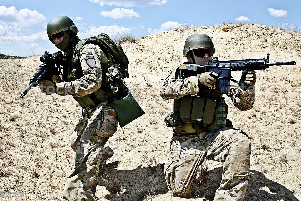 Two soldiers ready for a military operation stock photo