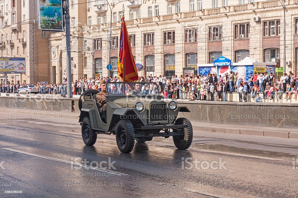 Two Soviet officers wearing WWII uniform with colours in GAZ-67 royalty-free stock photo
