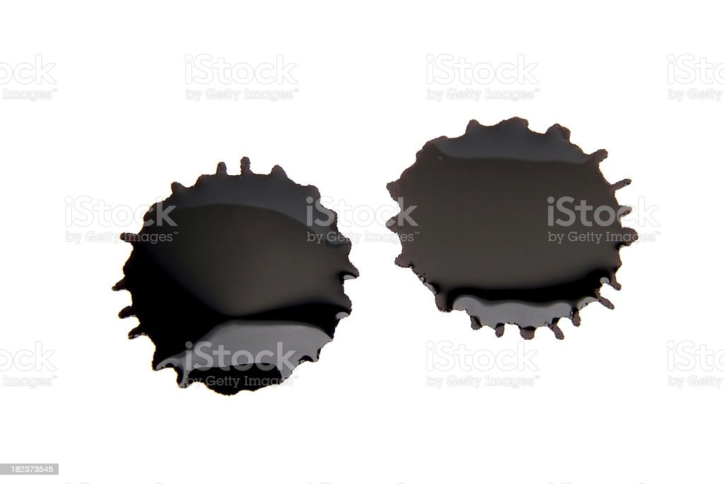 Two splats of black ink on a plain white background royalty-free stock photo