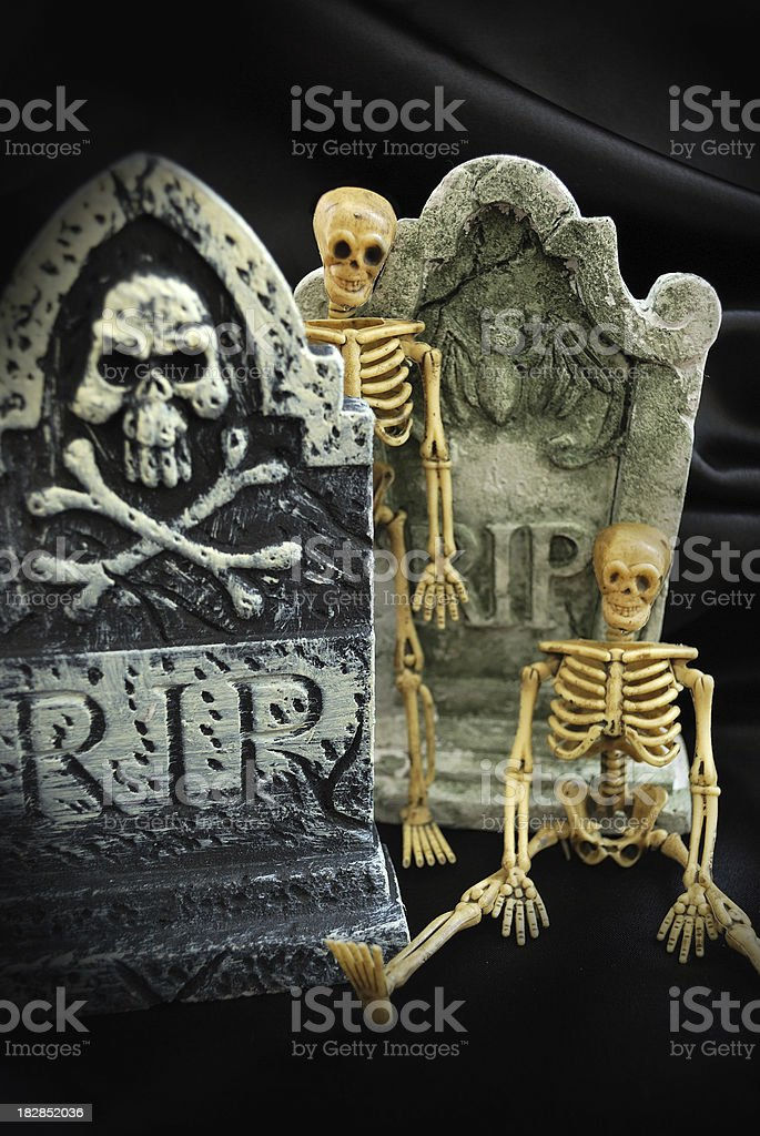 Two Spooky Halloween Skeletons with R.I.P. Tombstones stock photo