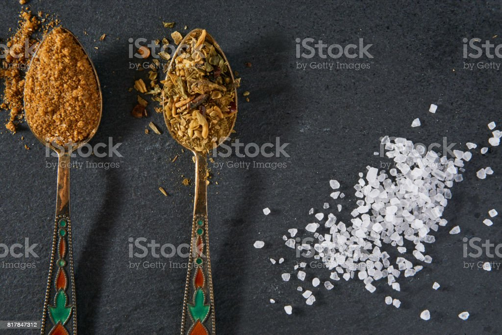 two spoons of seasoning spices and sea salt stock photo