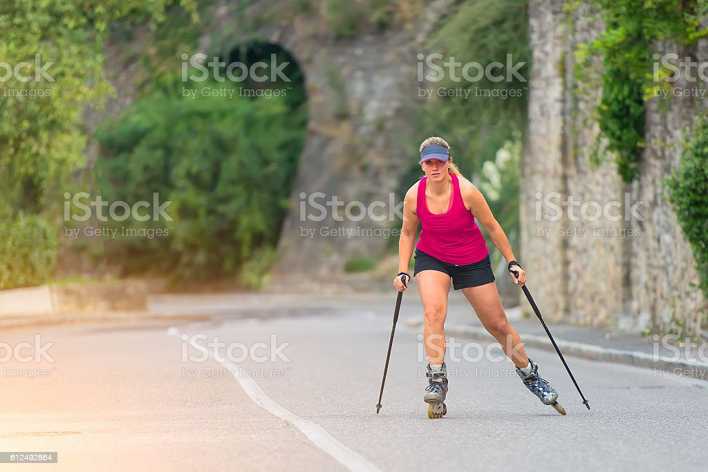 Two sports girl in a tennis Rollerblade stock photo