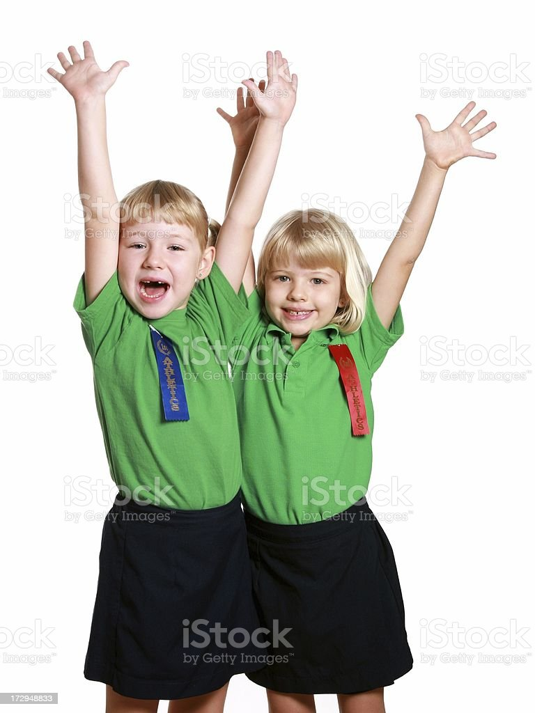 Two Sports Girls with arms raised on white background winners royalty-free stock photo