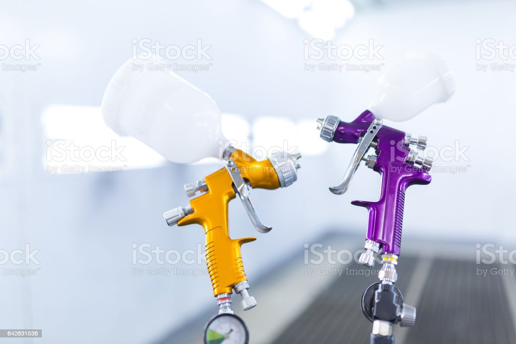 Two spray gun workshop in paint chamber stock photo