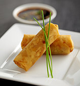 Two Spring rolls on a plate with dip