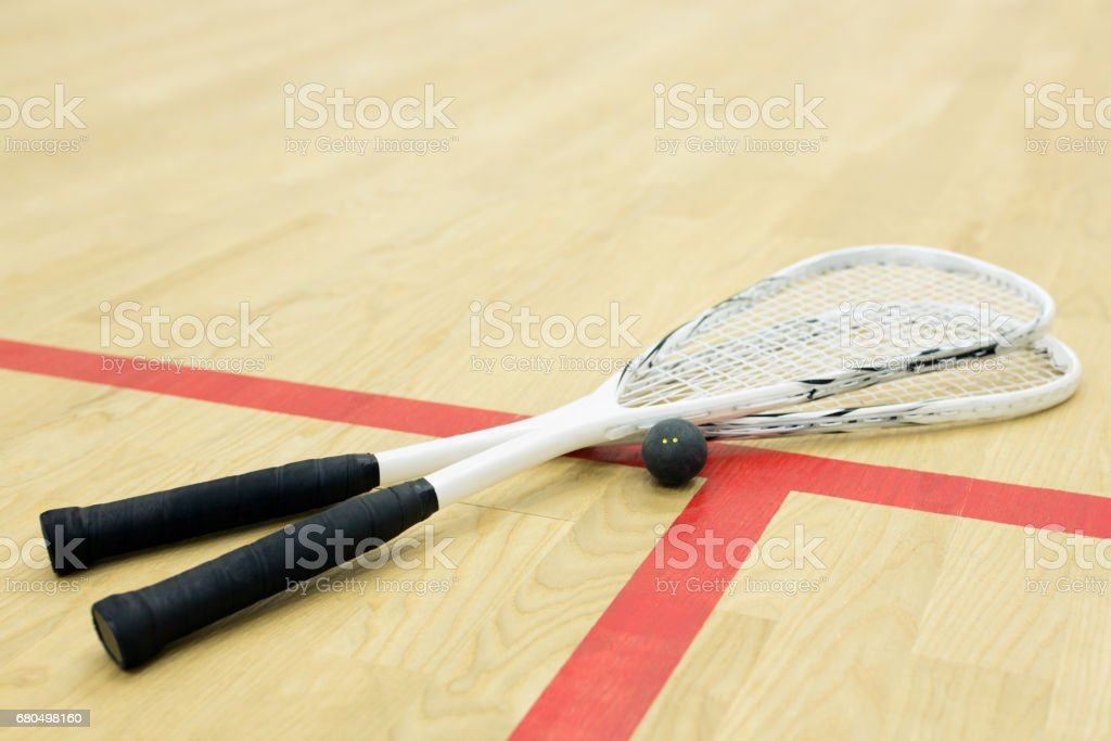 two squash rackets and ball stock photo