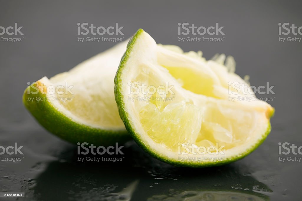 Two Squeezed Limes stock photo
