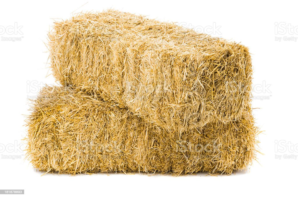Two stacked bales of hay on white background stock photo