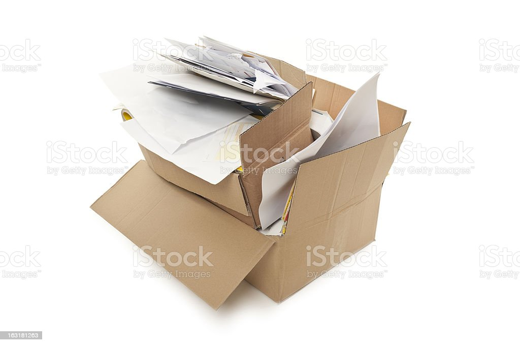 Two stacked cardboard boxes overflowing with office papers  stock photo