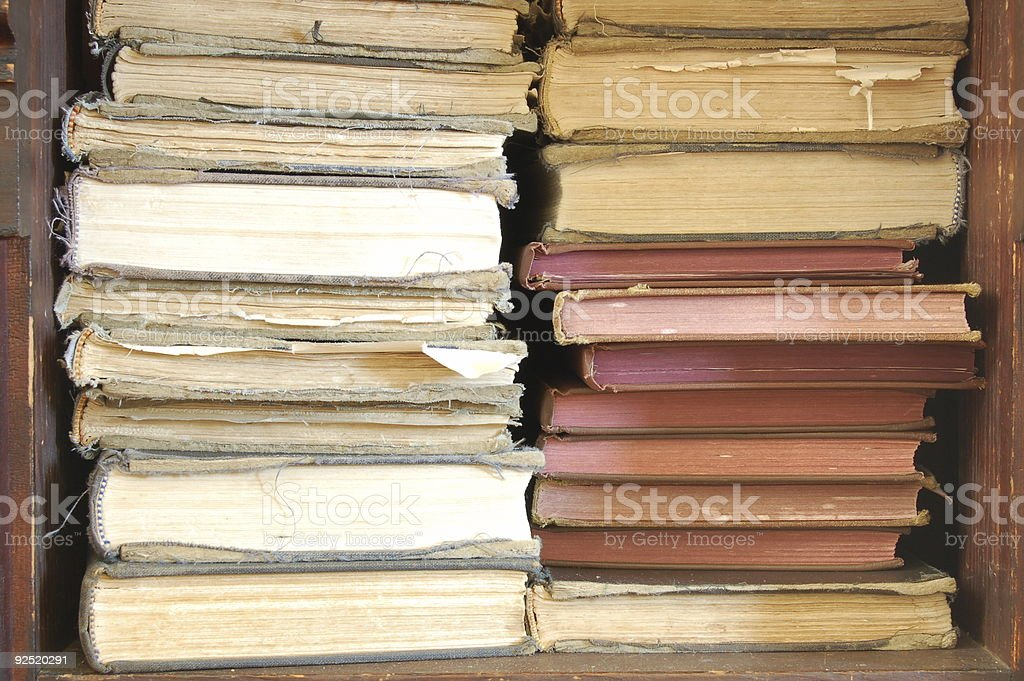 Two stacks of old books stock photo