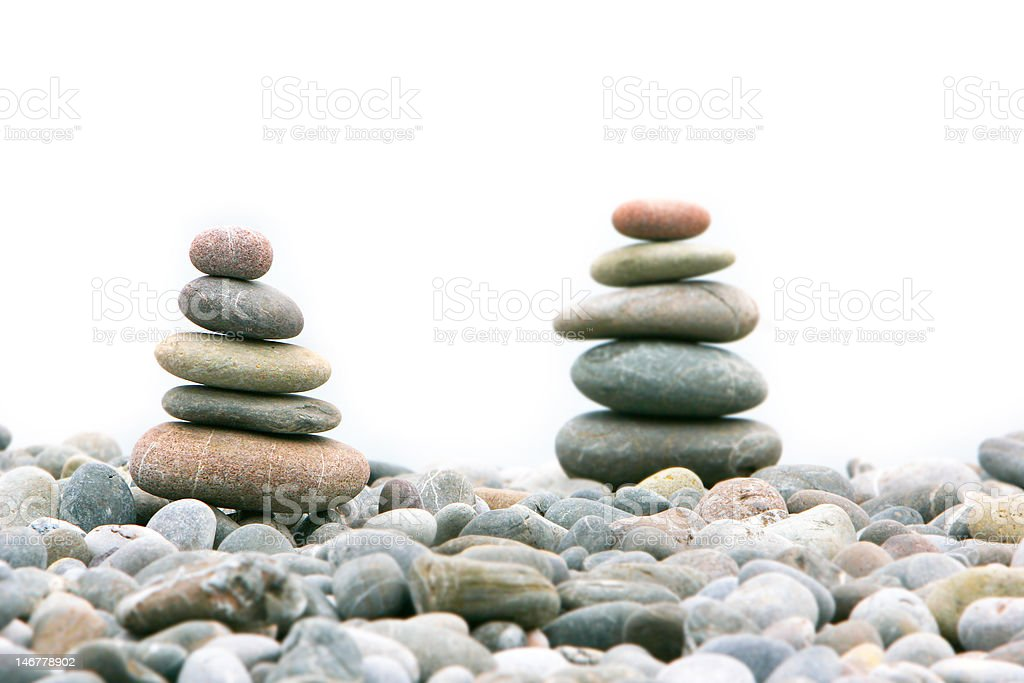 two stacks of stones over white royalty-free stock photo