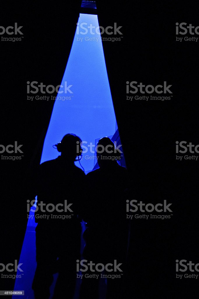 Two stage hand silhouettes visible through a curtain opening stock photo