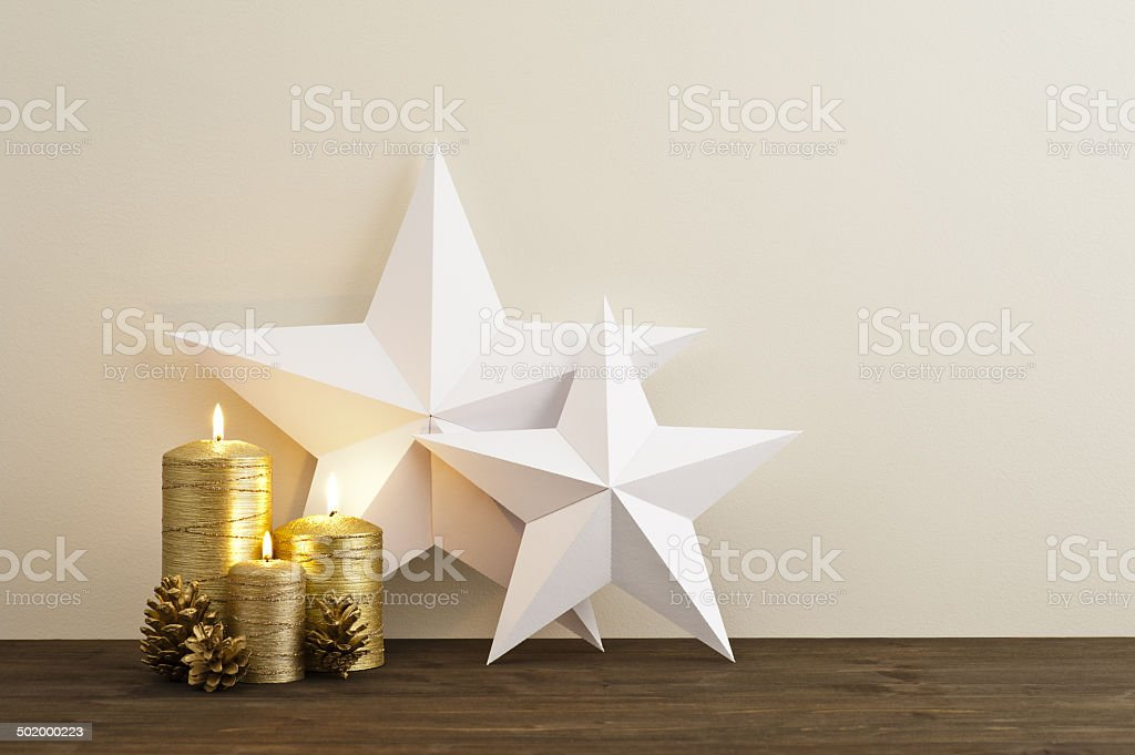 Two stars with golden candles stock photo