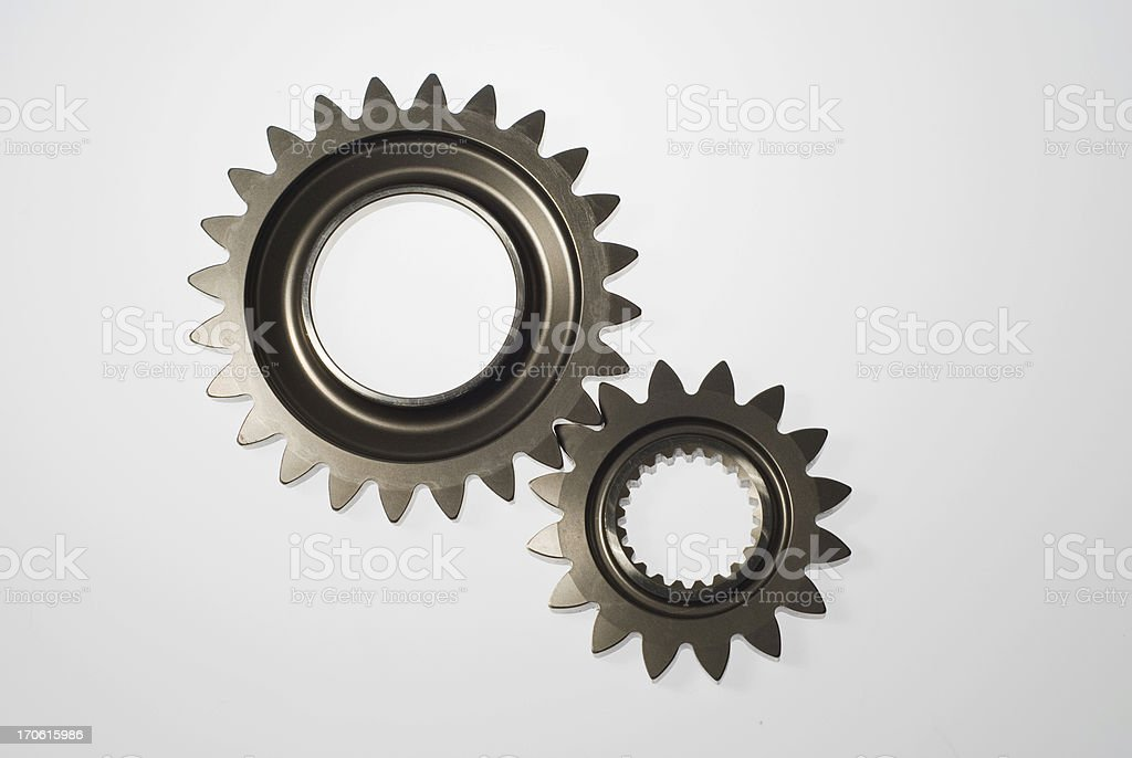 Two steel gears in mesh isolated stock photo