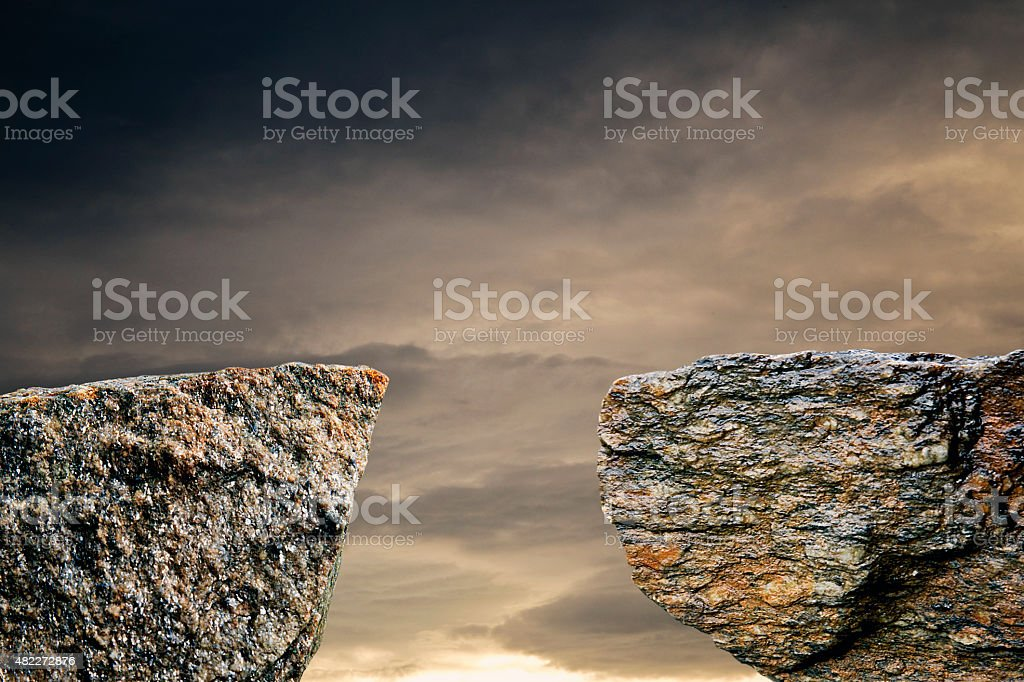 Two stone cliffs with a gap stock photo