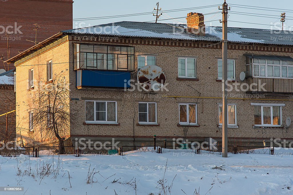 Two storey old brick house winter day stock photo
