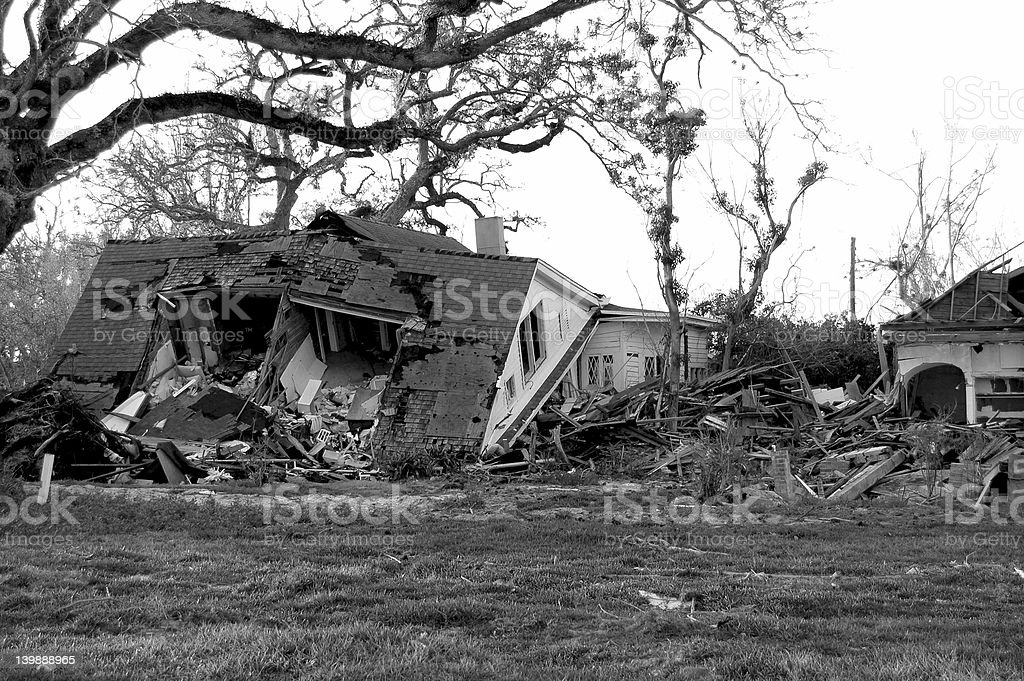 A two story house destroyed by a natural disaster stock photo