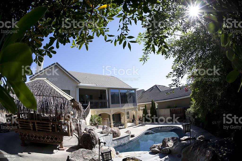 Two story house trees backyard swimming pool royalty-free stock photo