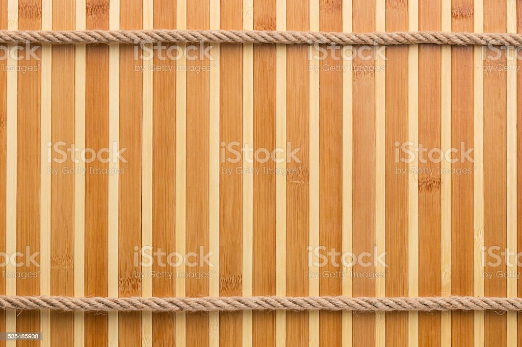 Two straight rope on a bamboo mat stock photo