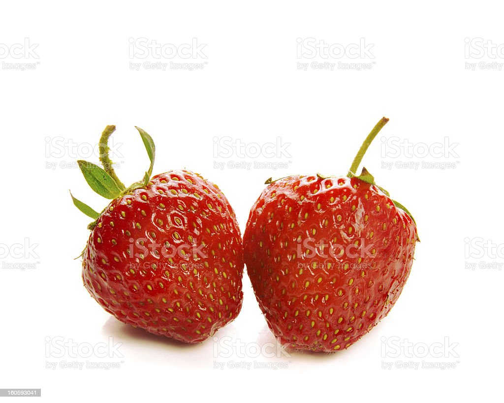 Two strawberries isolated on a white royalty-free stock photo