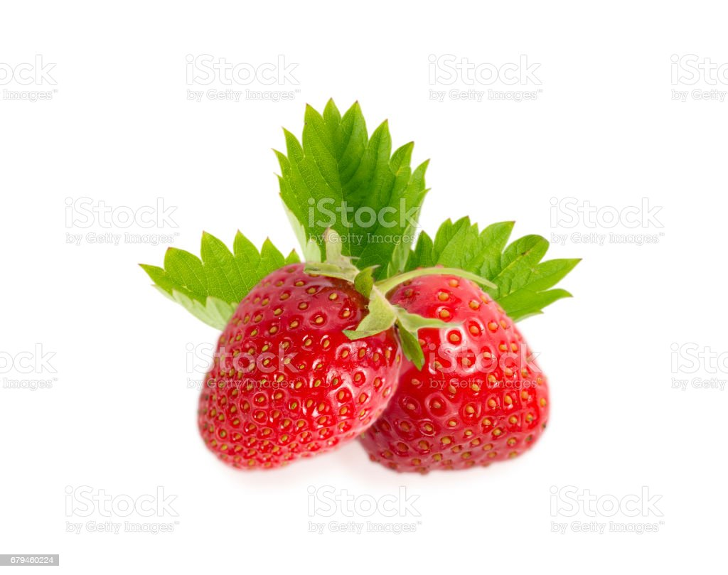 two strawberries with leaves isolated on white background. stock photo