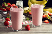 Two Strawberry Banana Yogurt Smoothies in Glasses with Ingredients