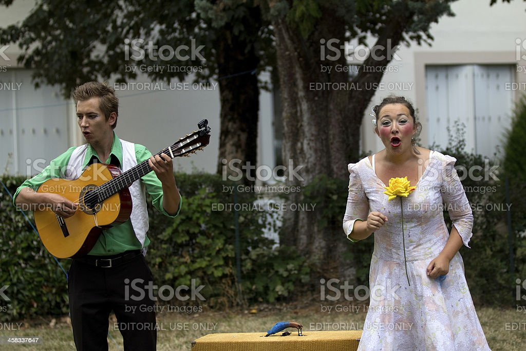 Two street performers play in a square. royalty-free stock photo