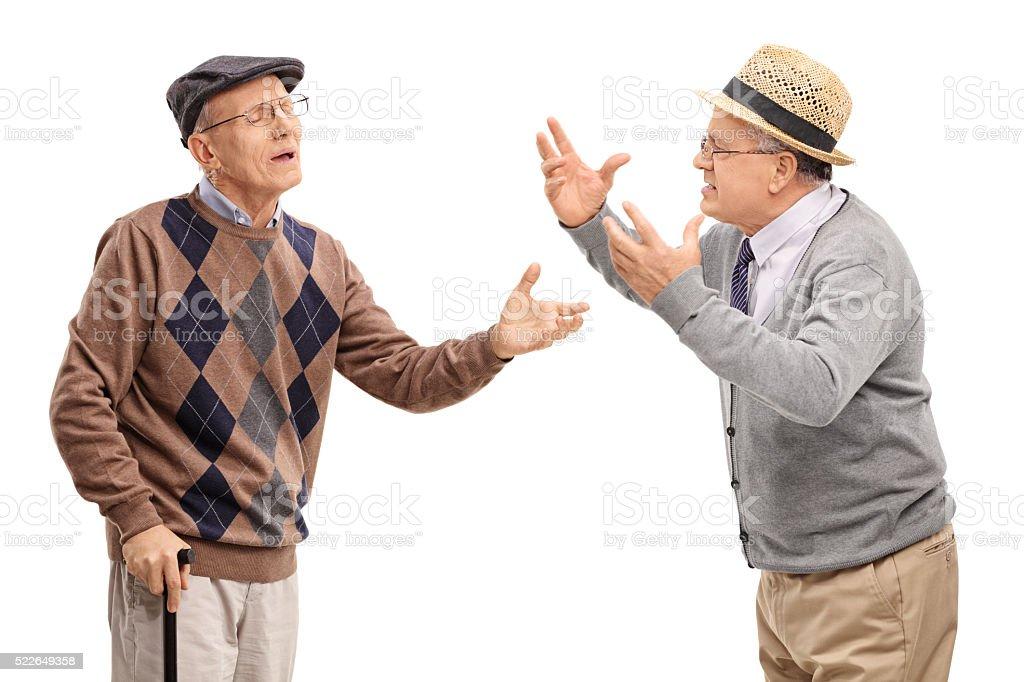 Two stubborn mature men arguing stock photo