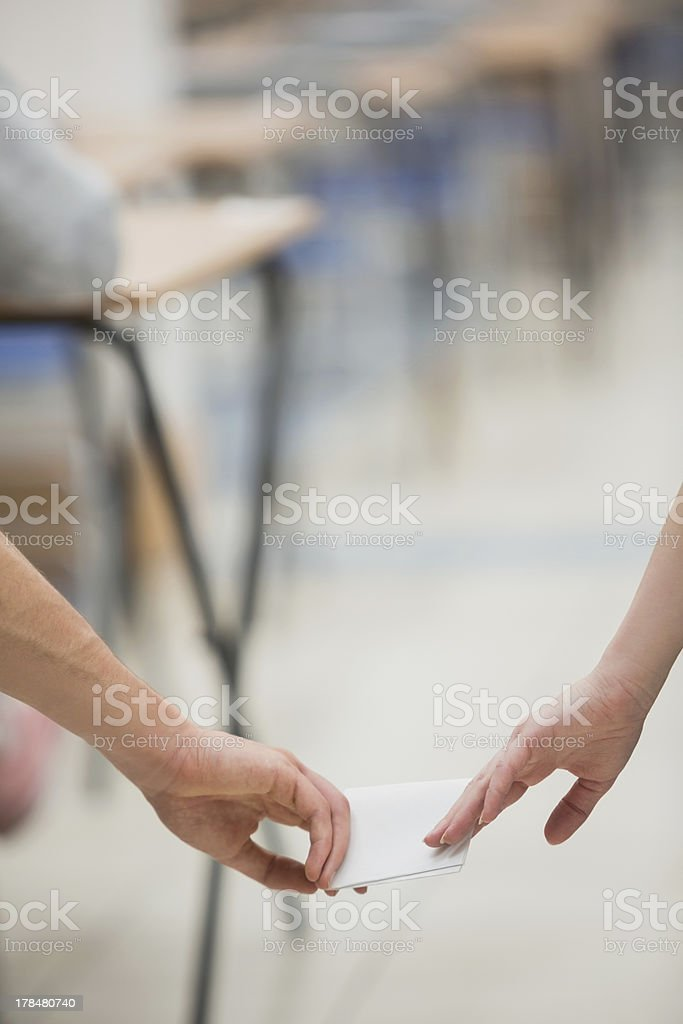 Two students cheating while doing a test royalty-free stock photo