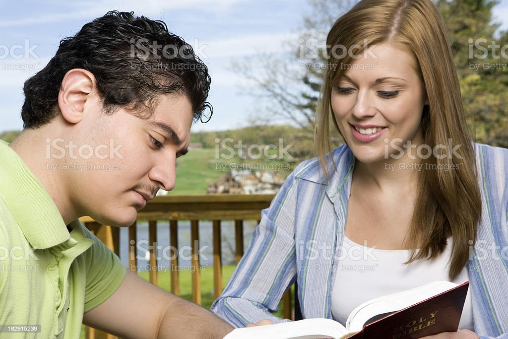 Two Students Having Bible Study on Deck stock photo