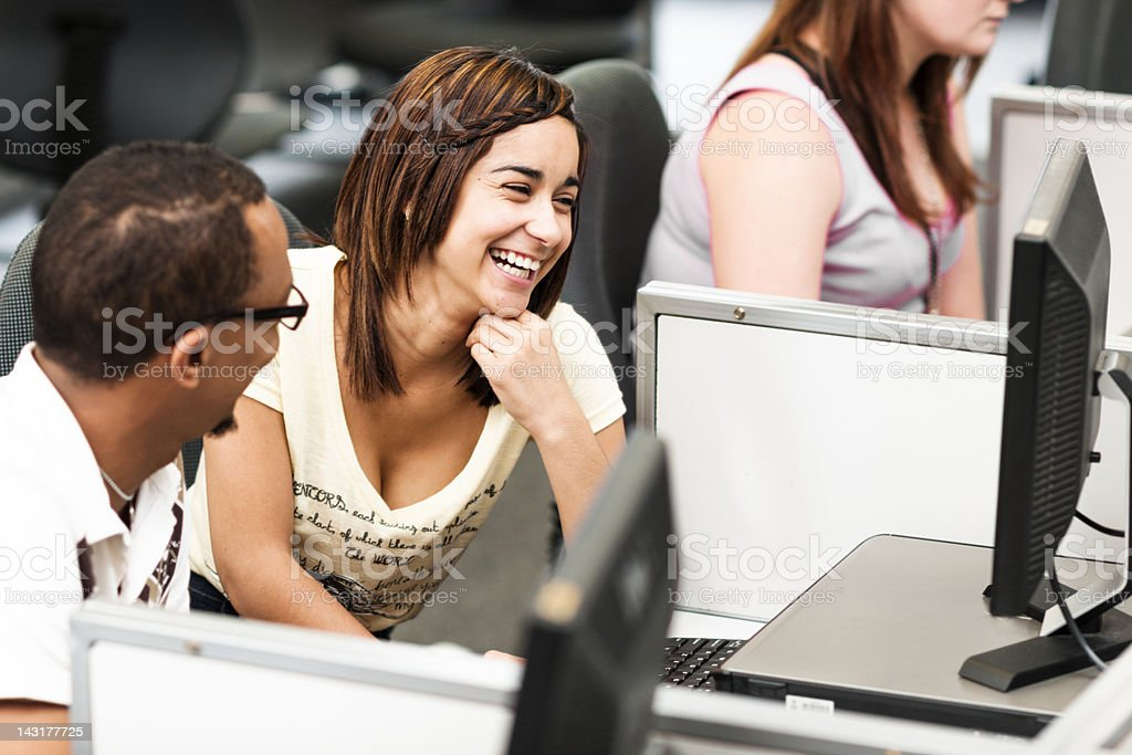 Two students in computer lab royalty-free stock photo