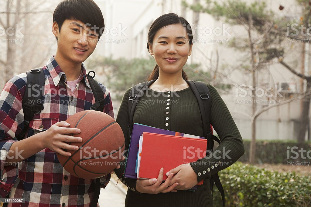 Two students portrait on college campus royalty-free stock photo