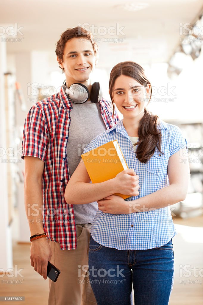 Two students reading at library royalty-free stock photo