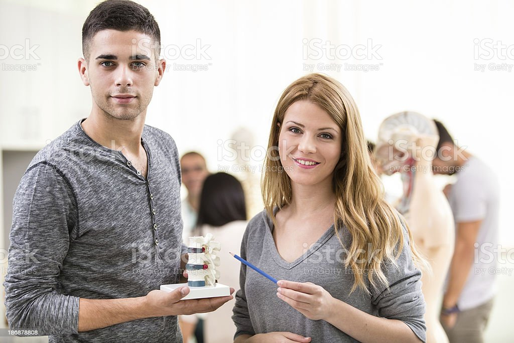 Two students studying human spine royalty-free stock photo