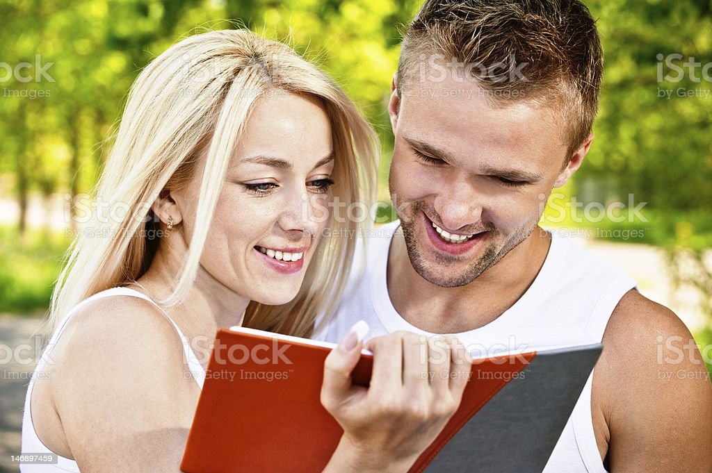 Two students with book royalty-free stock photo