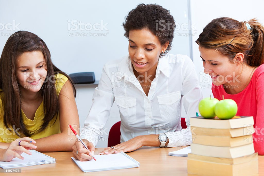 Two Students With Teacher Having An Informal Class stock photo