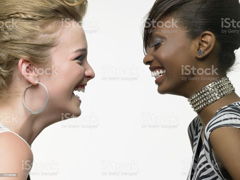 Two stylish young women stock photo