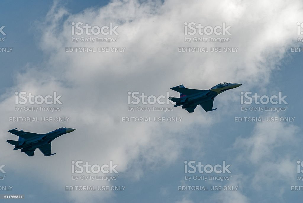 Two SU-27 fighters put bend stock photo