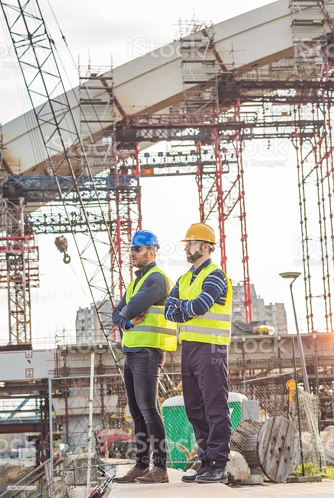 Two successful brdge builders stock photo