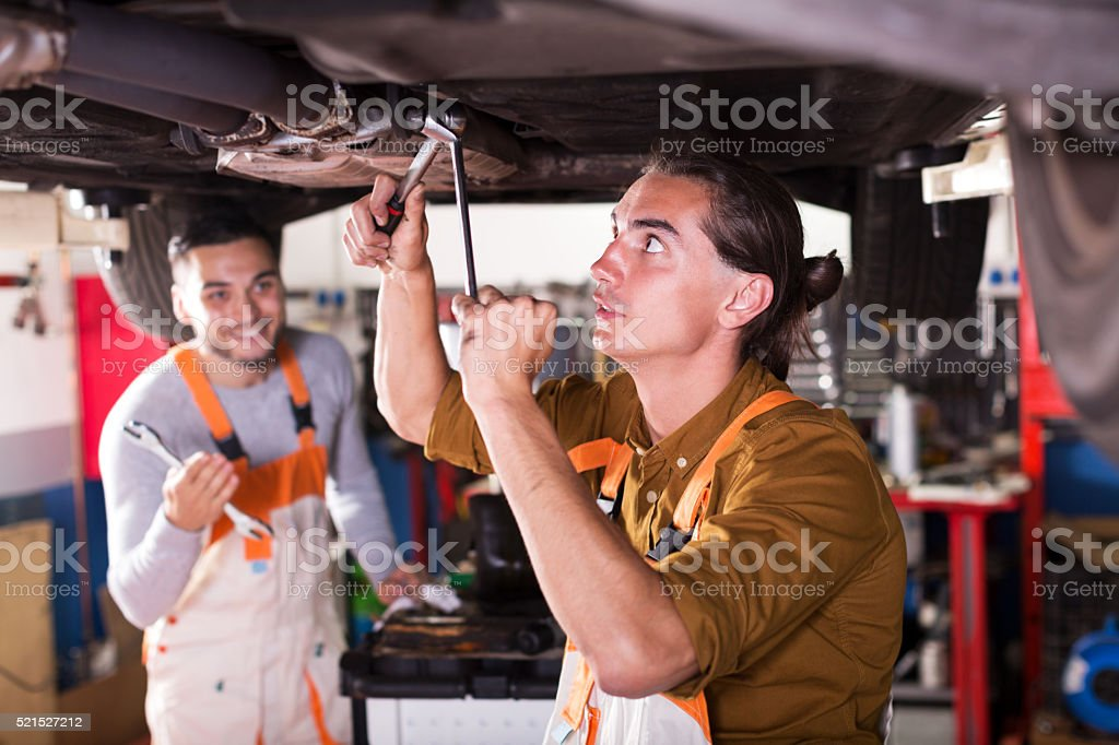 two successful car mechanics stock photo