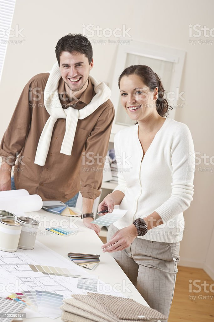 Two successful interior designer working at office with color swatch royalty-free stock photo