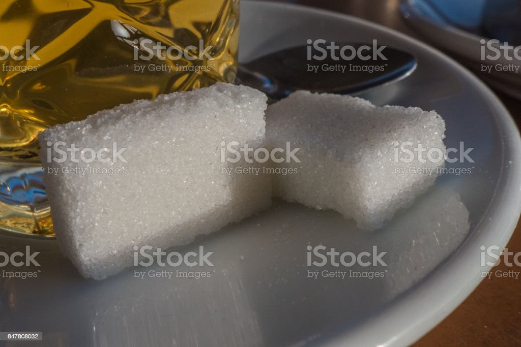 Two sugar cubes in a hot mint tea plate. stock photo